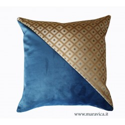 Blue velvet throw pillow with diamond-shaped gold-base...