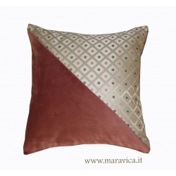 Pink velvet throw pillow with diamond-shaped gold-base...