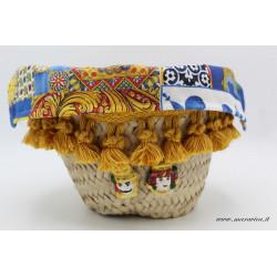 Sicilian coffa bread basket centerpiece with small...