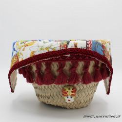Sicilian coffa bread basket with small ceramic moor's heads